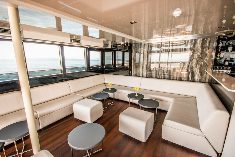 Check out the modern (and shaded) bar lounge aboard Out Adventures' gay cruise ship.