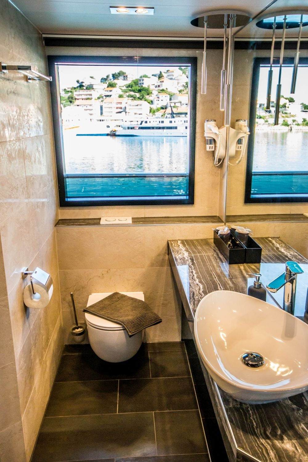 A preview of The Black Swan's private bathroom in an Upper Deck Cabin.