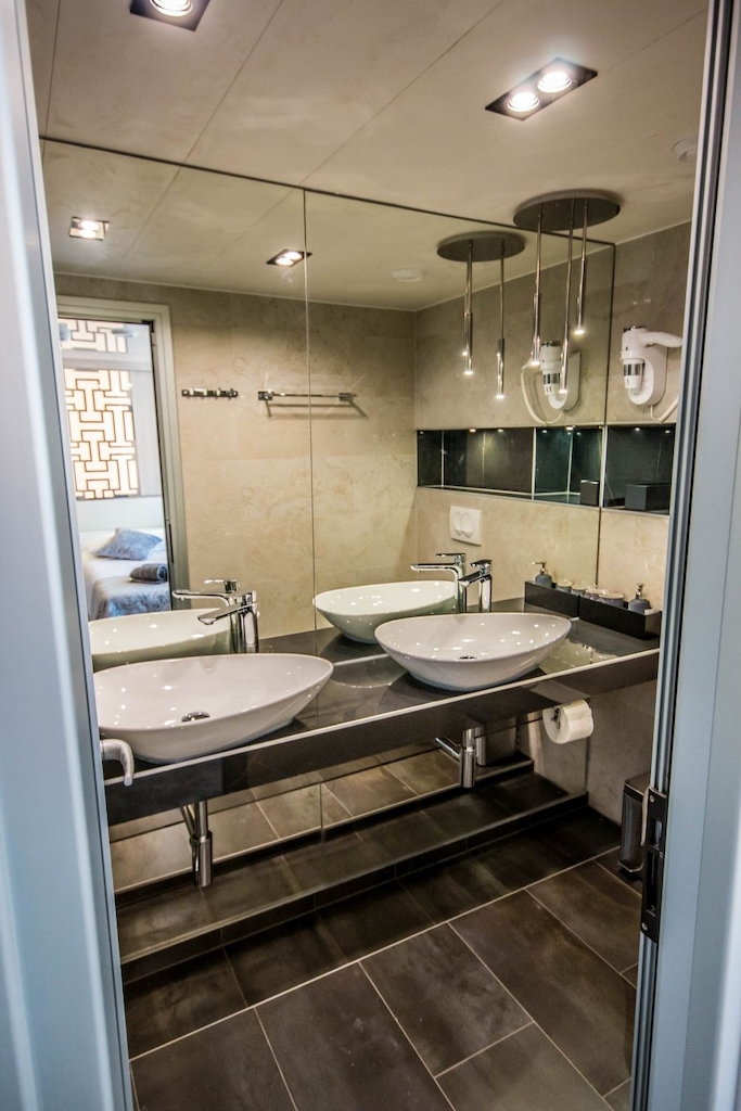 A preview of a lower cabin private bathroom.