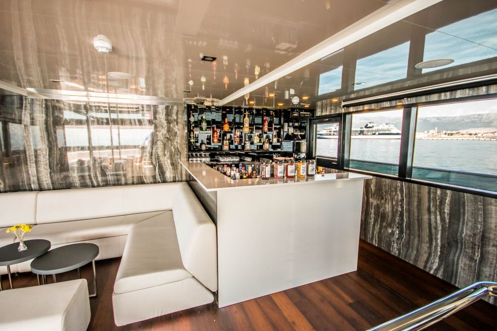 A snap showcasing the bar and lounge on Out Adventures' gay cruise ship.