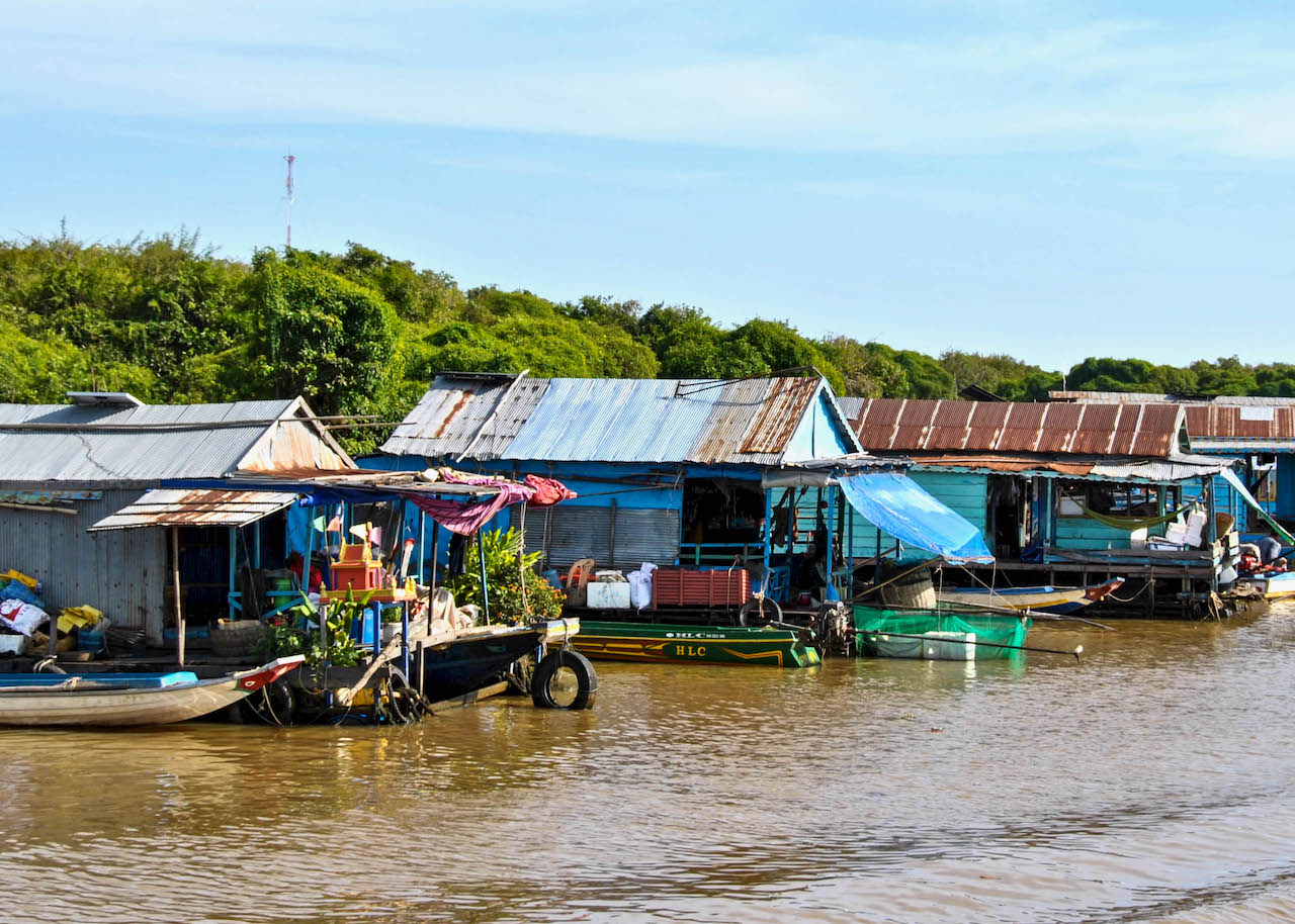Stilted houses and markets on the bank of the Mekong River.