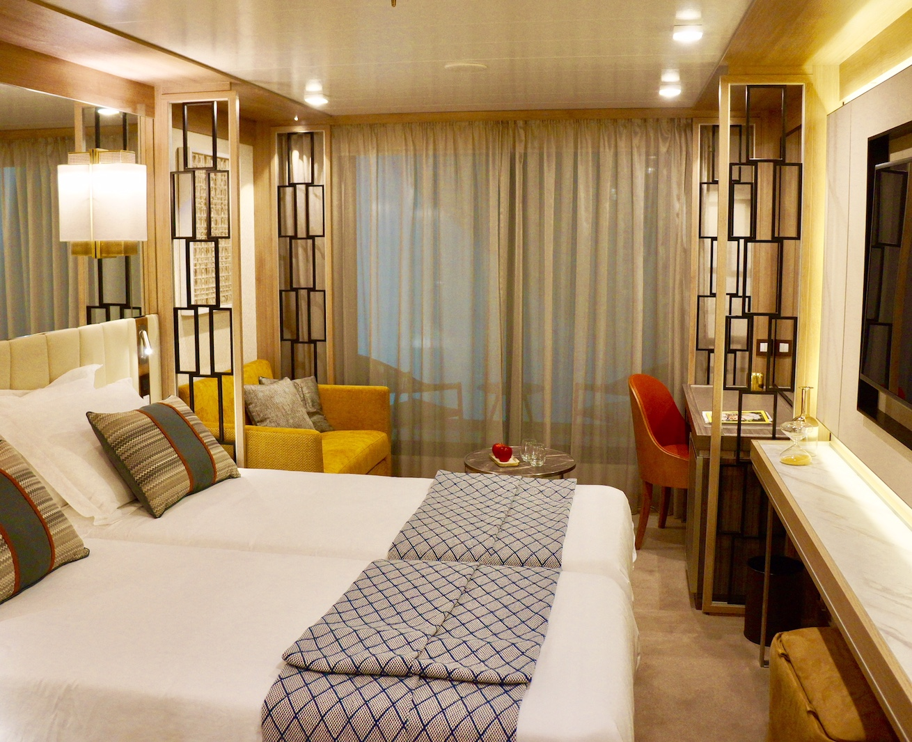 A preview of The World Explorer's Veranda Suite with a twin bed configuration.
