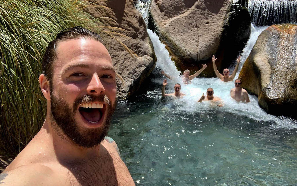 Robert Sharp takes a selfie on Out Adventures gay Chile tour above a natural hot spring.