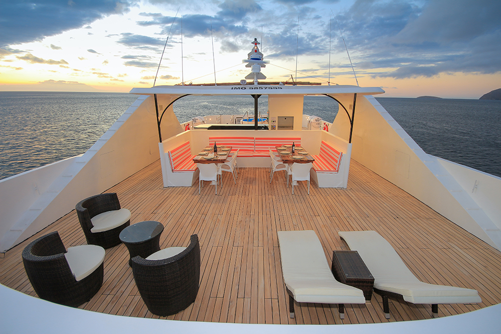 A gorgeous sunset photo of the Grand Queen Beatriz's top deck.
