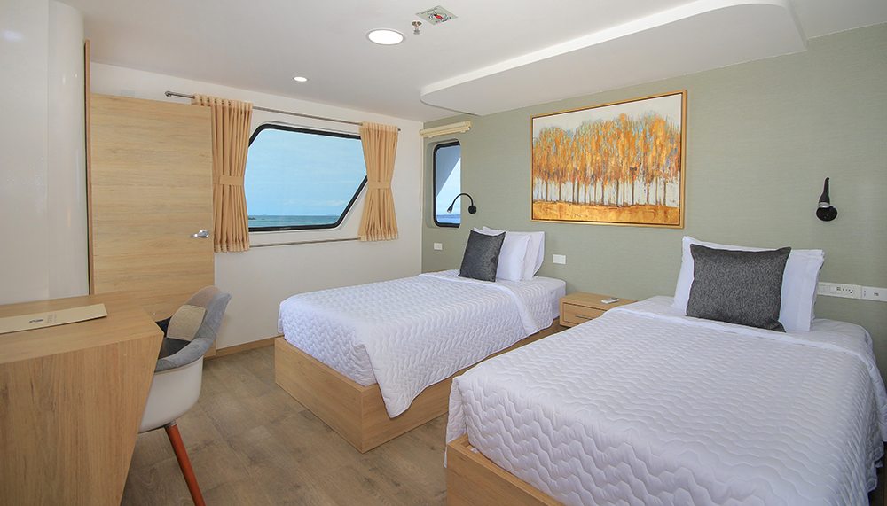 A preview of The Grand Queen Beatriz's Twin Balcony Suite.