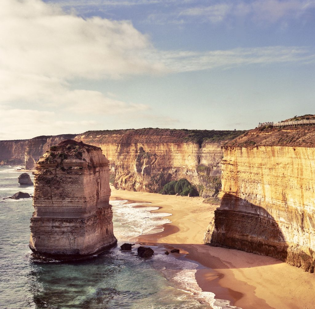 A scenic coast and one of the 12 Apostles along the Great Ocean Road.