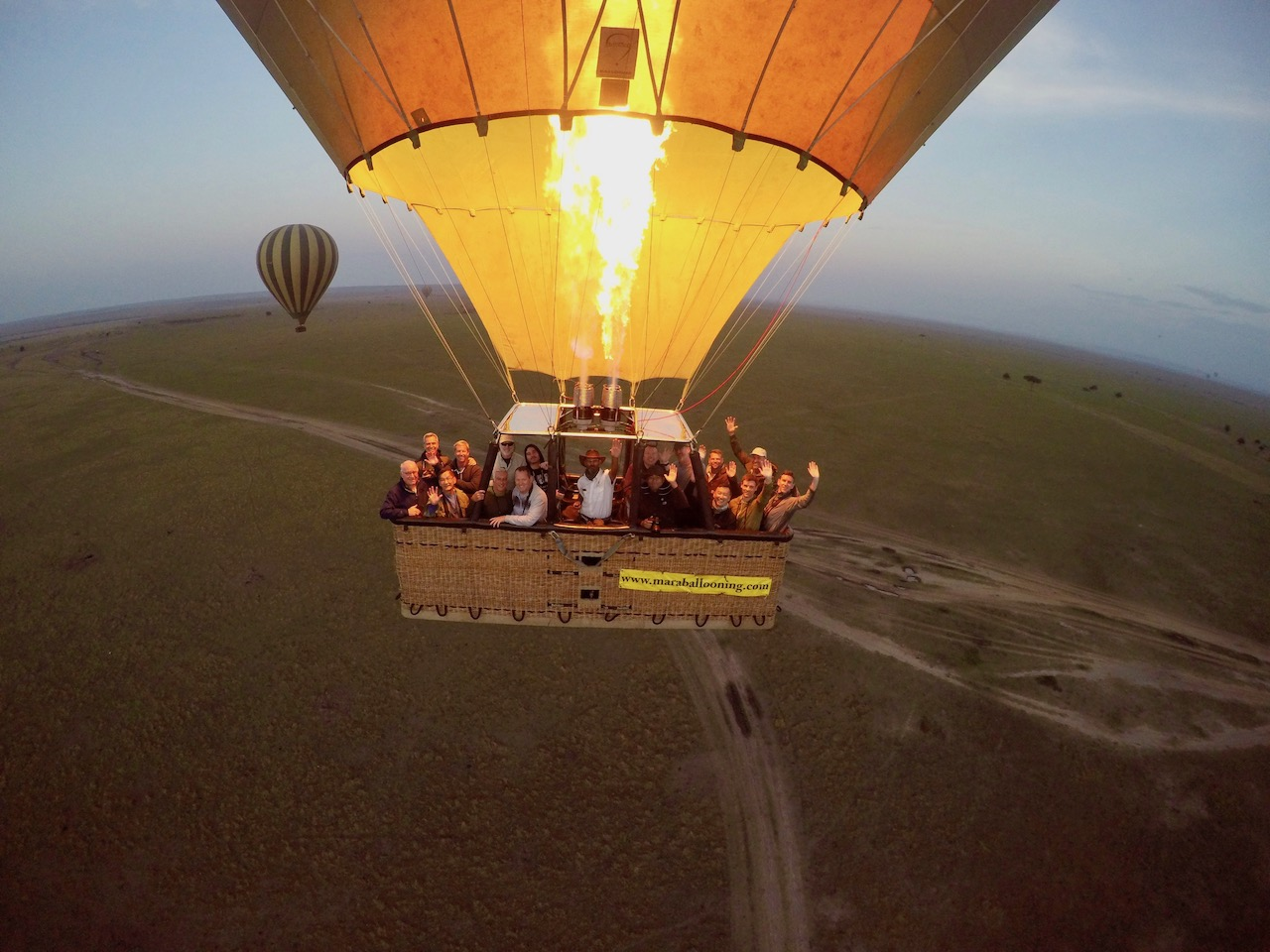 An Out Adventures group take a photo together while riding in a hot air balloon above Kenya.
