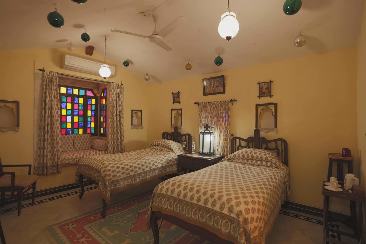 An example of the Grand Heritage Room outfitted with twin beds at Rawla Narlai.
