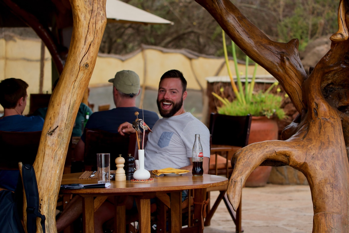 Robert Sharp, owner of Out Adventures, enjoys lunch on the company's gay Kenya safari.
