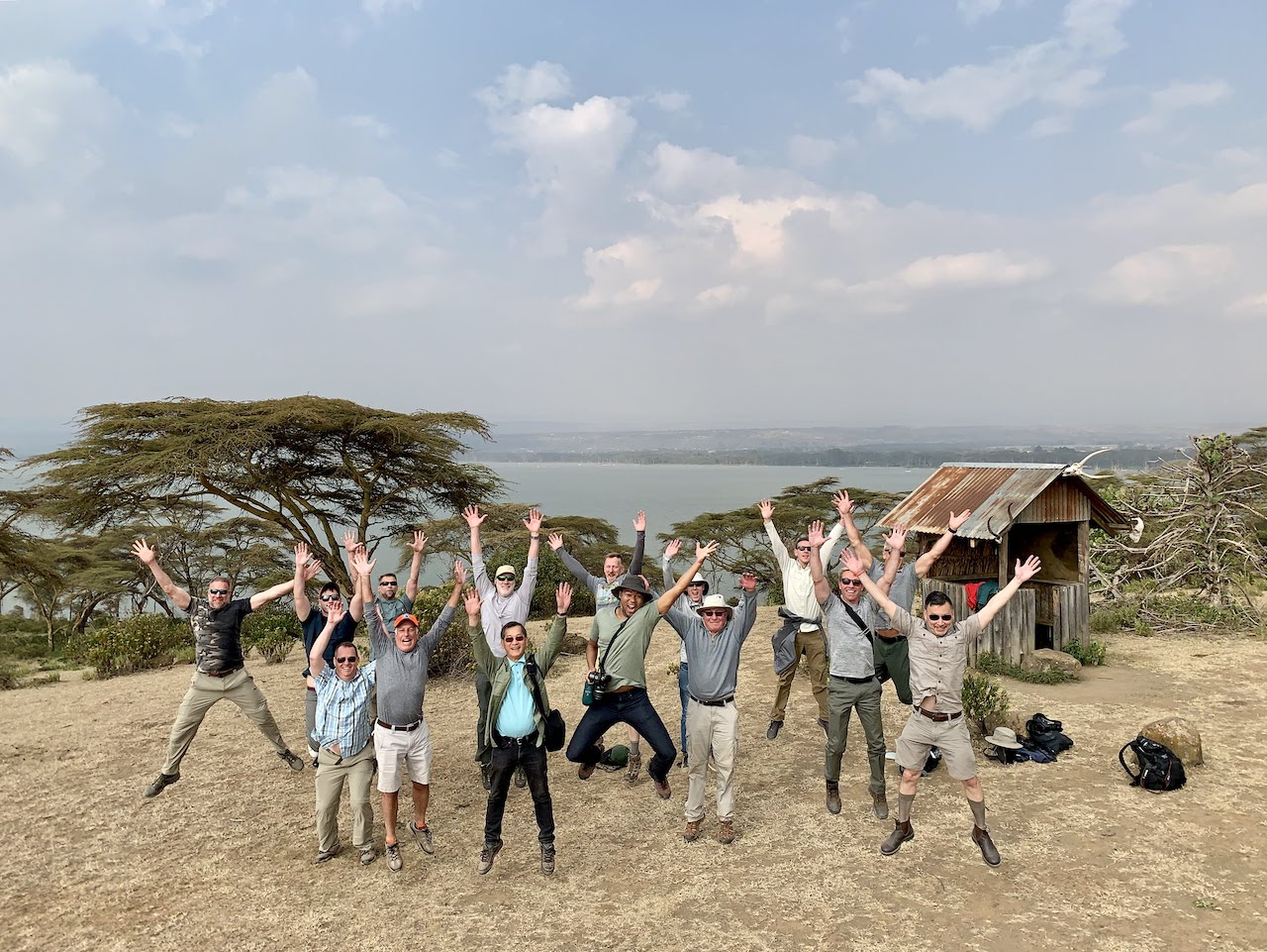 Out Adventures gay travellers jump for joy in unison over Lake Nakuru.