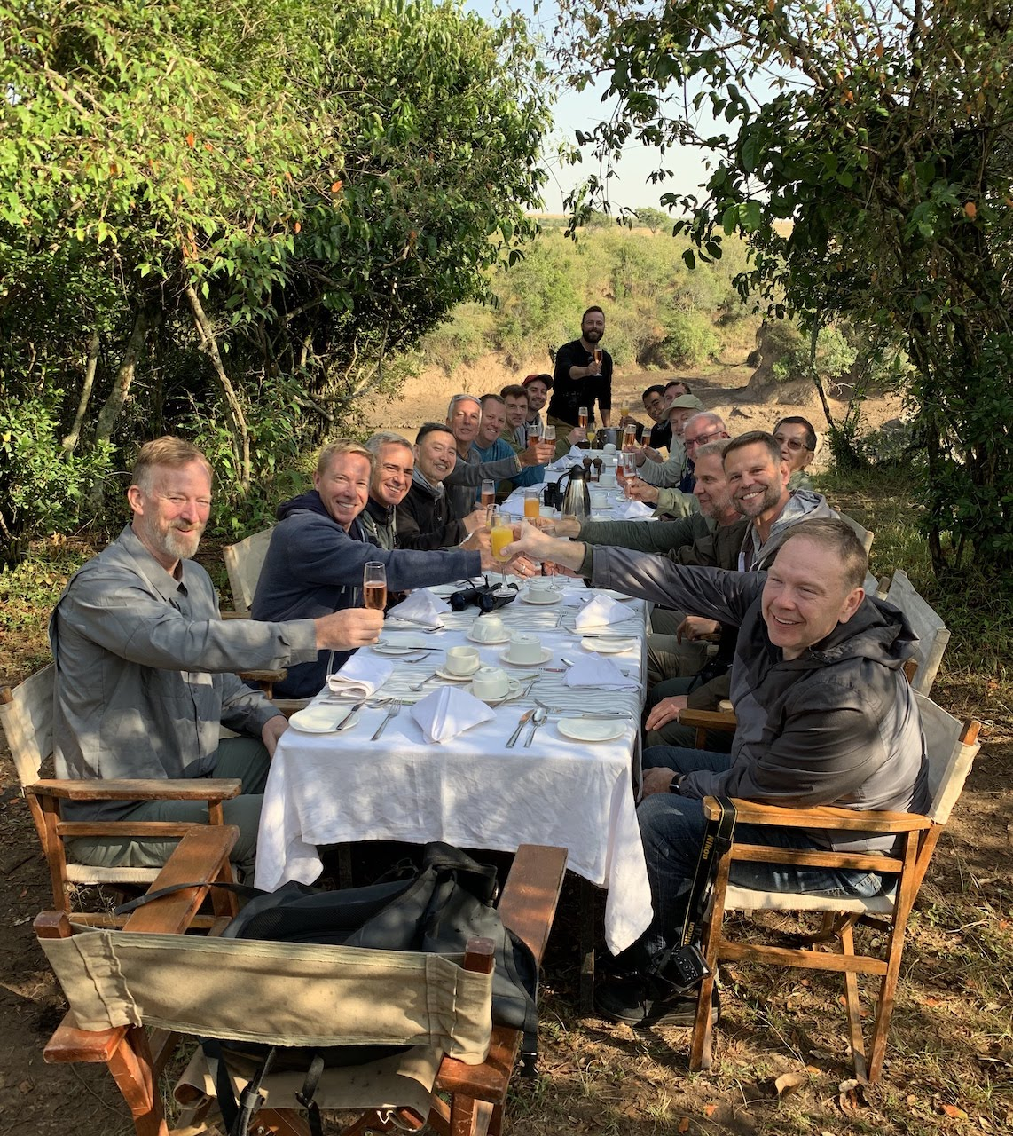 Travellers cheers each other at a unique bush lunch in Kenya.