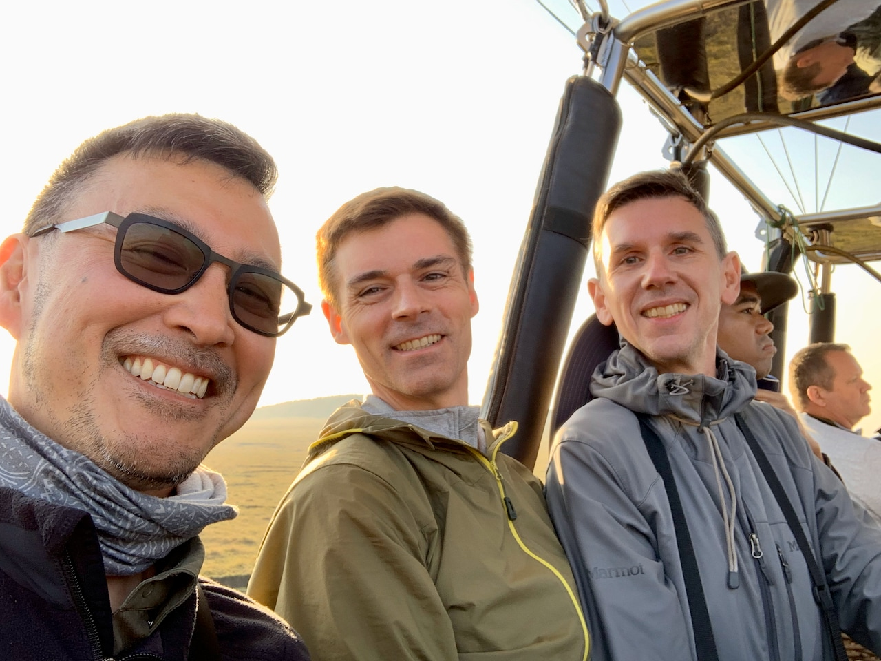 Three gay travellers prepare for a hot air balloon ride in Kenya.