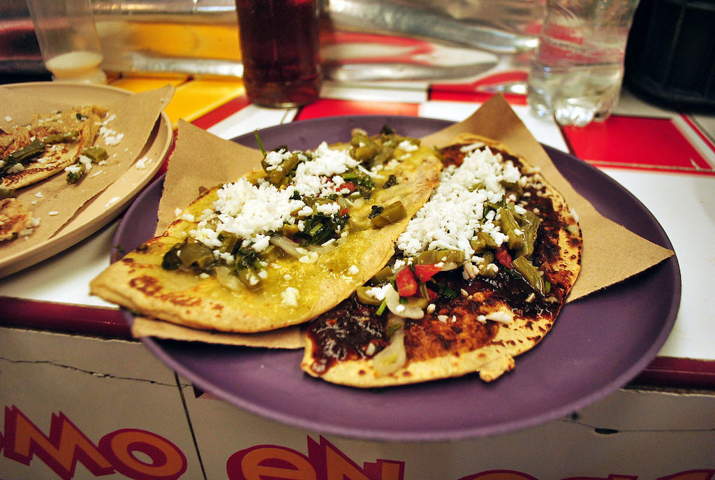 Two tlacoyos with nopales and cheese.