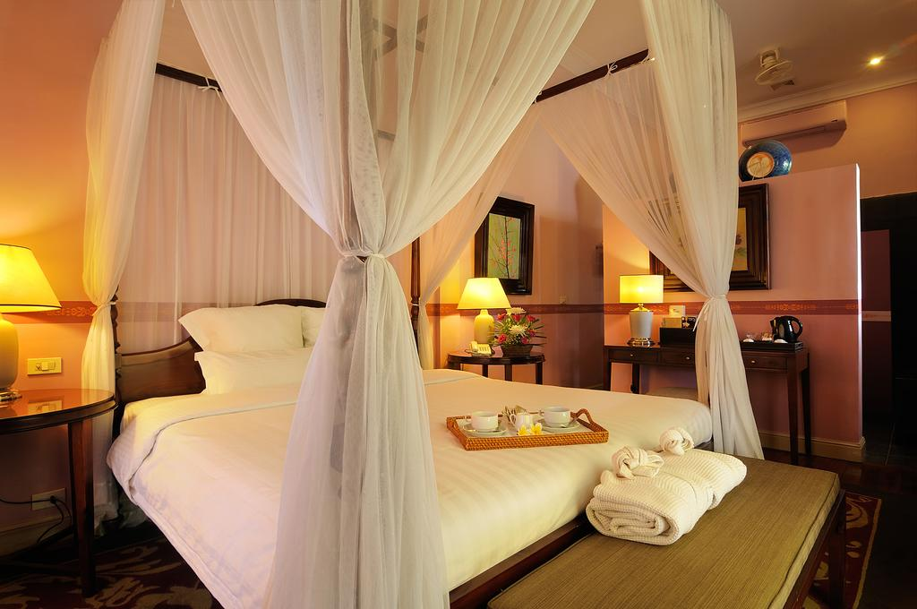 A double bed set up in Villa Maly, Luang Prabang.