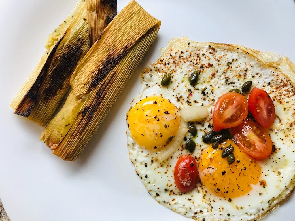 A picture of tamales with eggs.