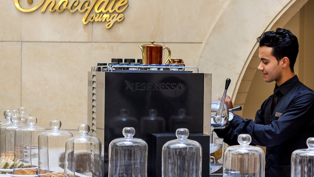 A barista making espresso at The Chocolate Lounge in the Kempinski Hotel in Cairo.