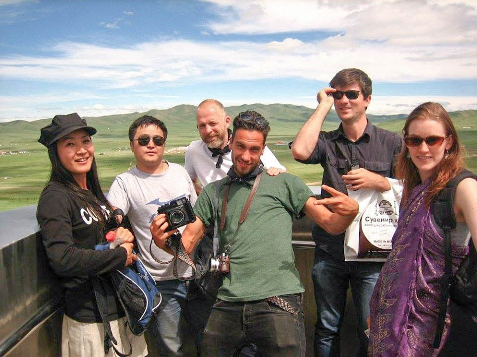 A small group of travellers posing in Bayan Ulgii, Mongolia.