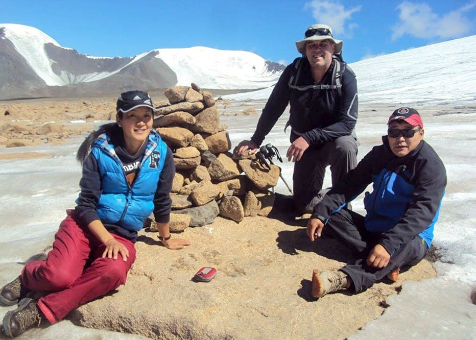 Three people enjoy a gay tour of Mongolia.