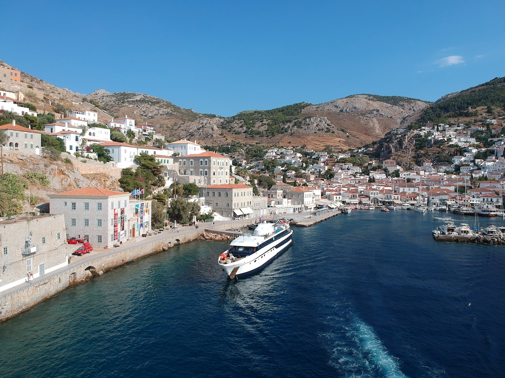 The Harmony G docked outside a small Italian port town.