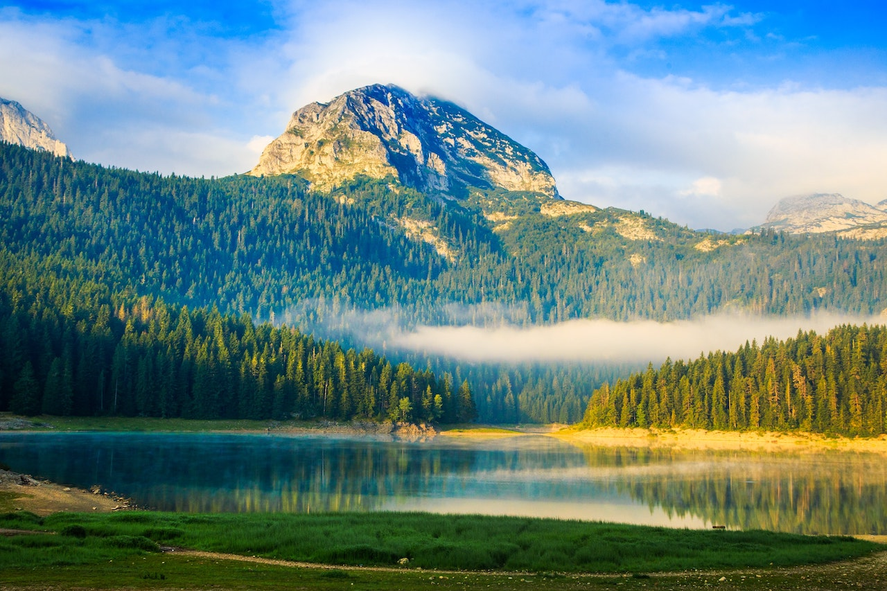 Morning haze over a lake in Durmitor National Park.