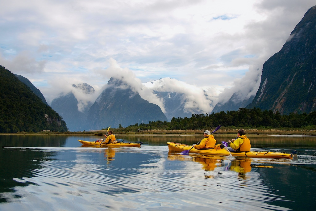 Three gay kayakers exploring New Zealand on Out Adventures' tour.