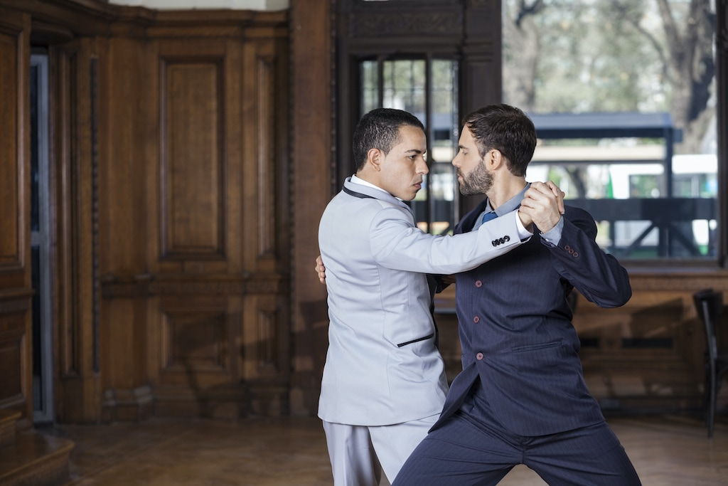 Two gay tango instructors dance together in Buenos Aires, Argentina.