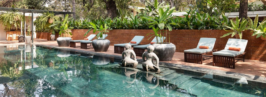 The pool and lounge chairs inside FCC Angkor by AVANI.