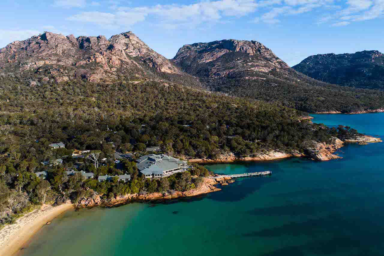 A bird's-eye view of Freycinet Lodge and its surrounding bush and coast.