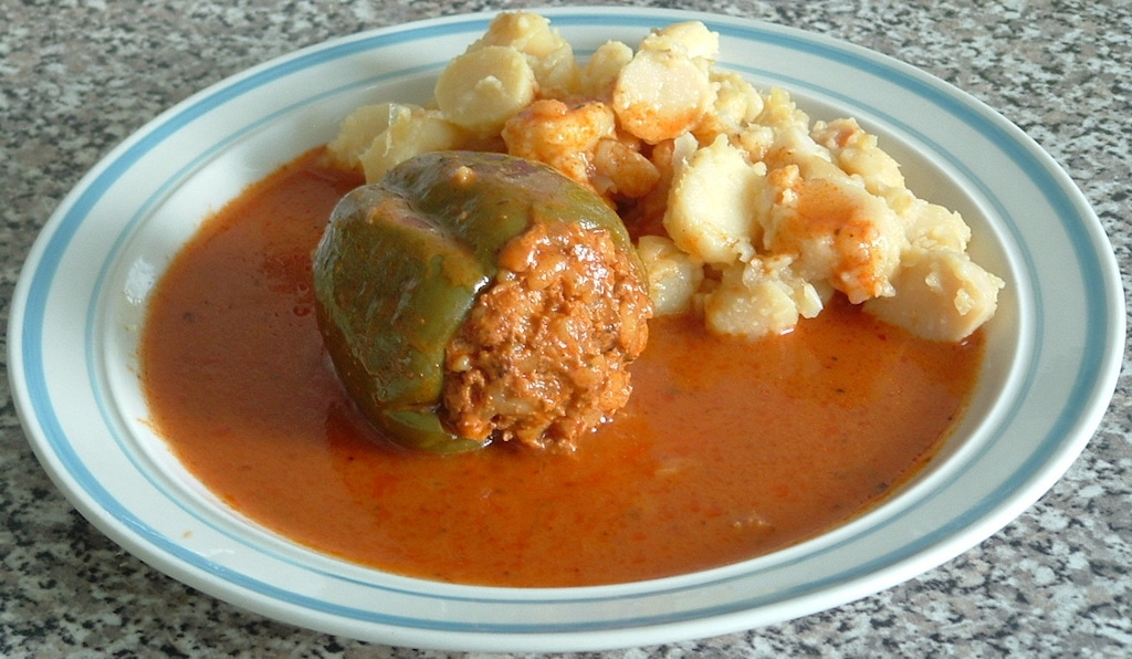 Croatian stuffed peppers, aka Punjena Paprika, are served with a thin tomato sauce and boiled potatoes.