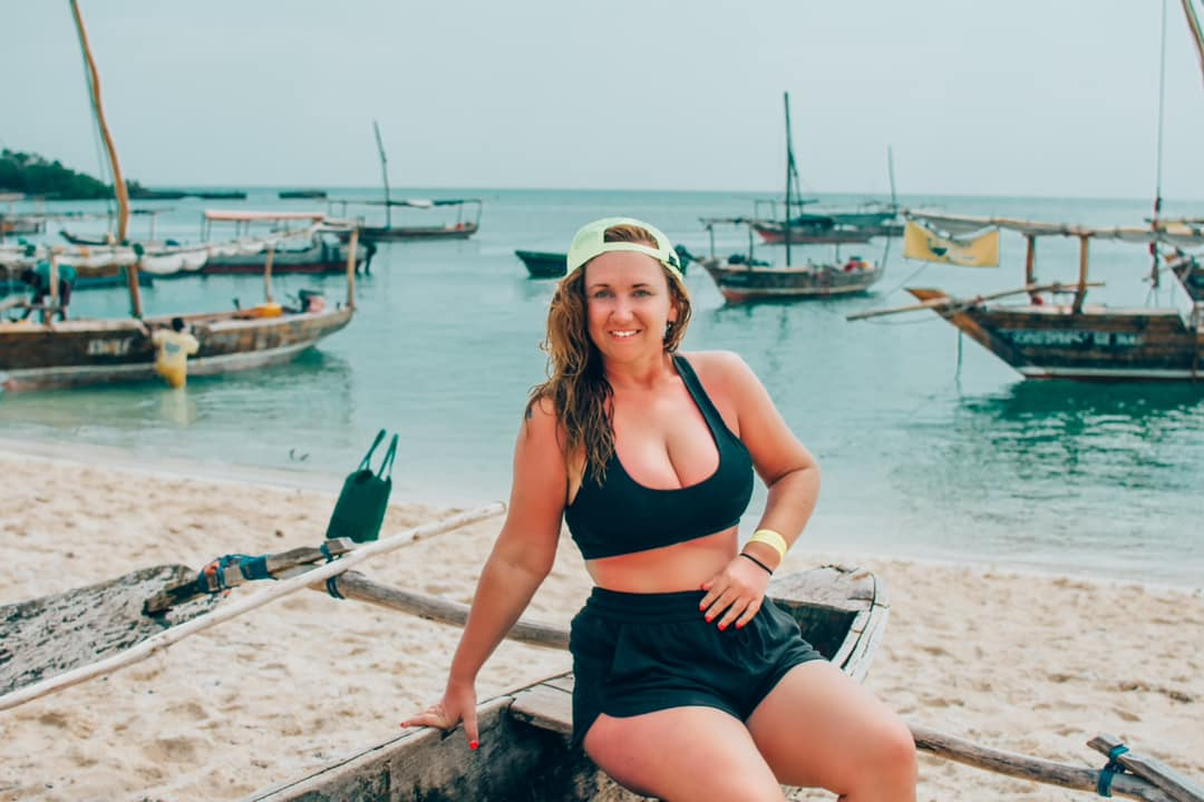 Still wet from swimming, Meg Ten Eyck poses for a picture on a beach in Zanzibar, Tanzania.