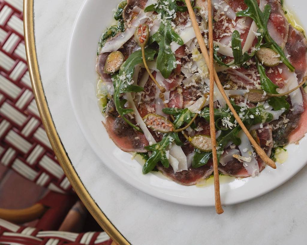 A beautiful plate of beef carpaccio at Kirk's Wine Bar.