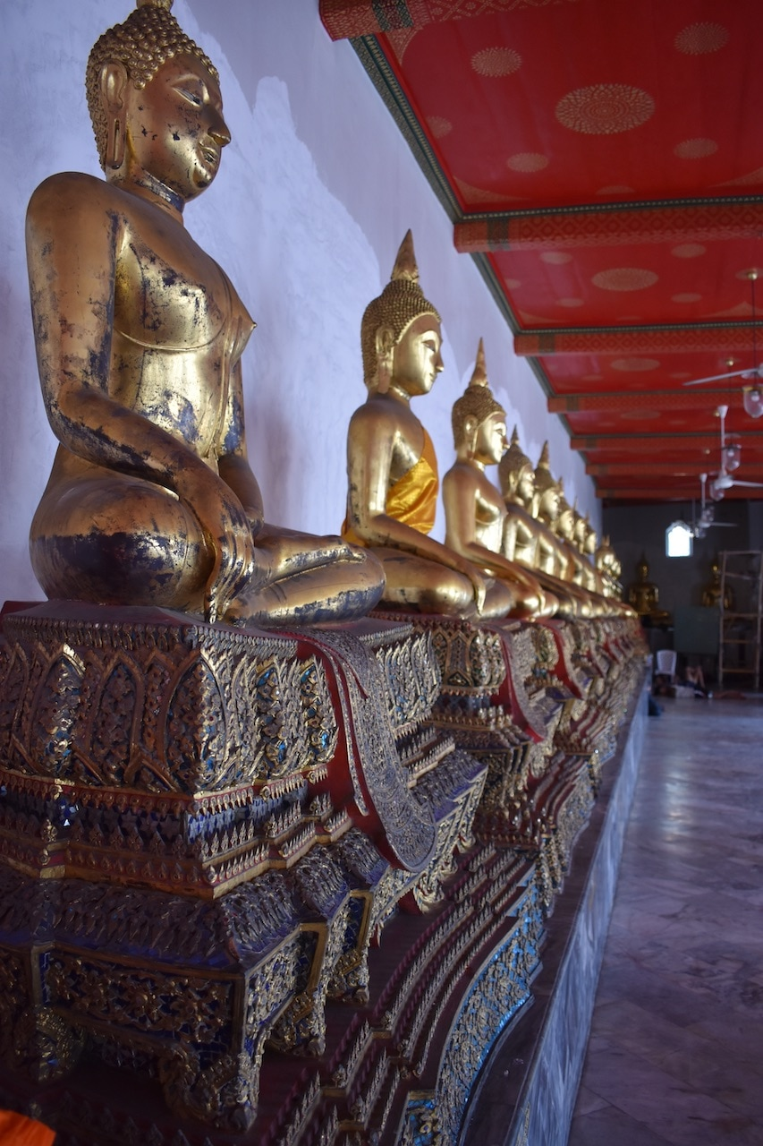 Buddhist statues lined up inside The Grand Palace.